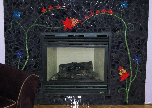 <h5>Mosaic Fireplace</h5><p>Custom-made mosaic fireplace surround with floral inlay. EspressO 6 glaze.</p>
