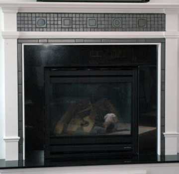 <h5>Color Blocks Fireplace</h5><p>Custom Made 4x4 Color Blocks in glaze Griffen #85 surrounded by handmade 1x1 field in glaze Griffen #85.</p>