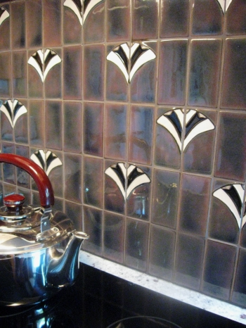 "<h5>Tivoli Backsplash</h5><p>Tivoli is made up of two 2""x4"" tiles placed side by side.  Shown with glaze EspressO #65 background with white and gloss black accents.  Field tile is 2x4 in glaze Espresso #65.</p>"