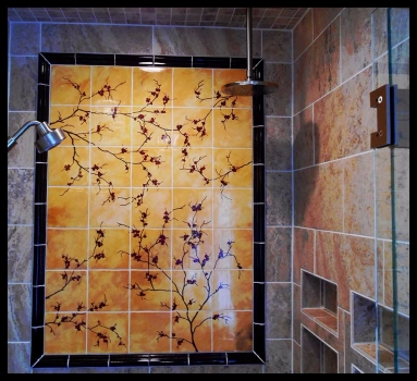 <h5>Cherry Branche Mural</h5><p>This 3' x 5' mural was custom made to order for the client.  It is hand painted on 6x6 tiles and trimmed with Chair Rail boarder in glaze Treasure #205.  </p>