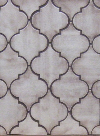 "<h5>Trellis</h5><p>Custom made field tile in the classic ""Arabesque"" design in sepia tone glaze.</p>"