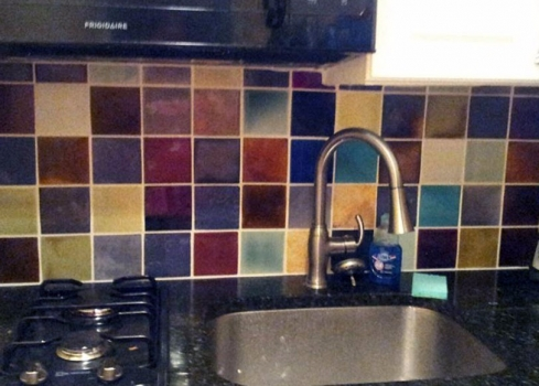 <h5>Modern Backsplash</h5><p>Multi-colored 4×4 mosaic backsplash in Manhattan loft.</p>