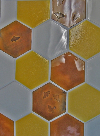 "<h5>HEX</h5><p>Field tile in ""Honey Comb"" pattern with Bee impressions.  Glaze: Karmel 105, Flurry 73 & Chamomile 45</p>"
